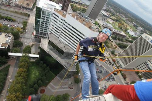 Miles Finch Innovation CEO, Tony Vengrove, rappels down the 400 ft. SunTrust building to help raise money for Special Olympics Virginia.